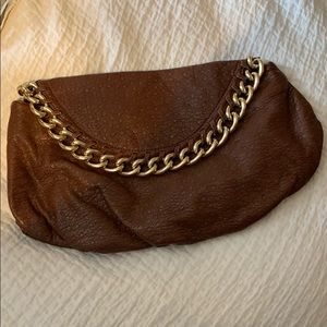 Brown and gold clutch